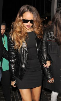 rihanna wearing a leather jacket, black short dress, rings
