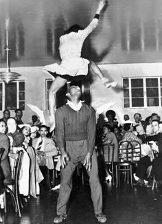 I am just in awe of the amount of height this young lady has in this picture.  I wonder if he somehow tossed her or if she made this leap on her own...?