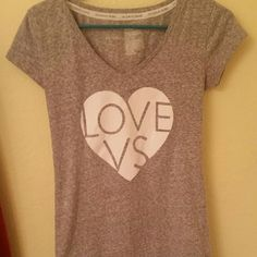Victoria's Secret t-shirt Victoria's Secret t-shirt with logo stating love vs. In a Heather gray size medium. Like new Victoria's Secret Tops Tees - Short Sleeve