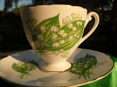 SHELLEY-DAINTY-LILY-OF-THE-VALLEY-FOOTED-CUP-AND-SAUCER-GOLD-TRIM