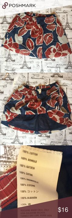 "Hollister Skater Skirt Red/White/Blue Floral EX SM Precious Hollister skater skirt in red, white and blue floral pattern.  This skirt is 100% cotton and has a navy blue lining.  The elastic waist measures 12"" unstretched.  The skirt measures 12"" long from waist band to lower edge trim.  This is a full skirt.  It measures 26"" across the bottom when measured laying flat.  This has the Hollister seagull embroidered on it.  SMOKE FREE HOME. Save money on shipping and BUNDLE Hollister Skirts Mini"