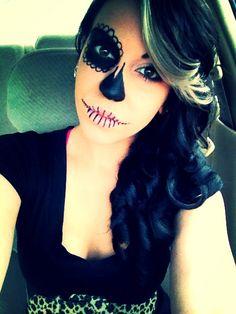 Sugar skull face make-up. Simple edition. Black eyeliner.