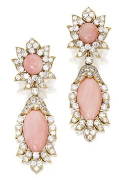 Pair of 18 Karat Gold, Coral and Diamond Pendant-Earclips, Van Cleef & Arpels, Paris. Suspending two coral cabochons measuring approximately 26.7 by 13.3mm, topped by two round coral cabochons measuring approximately 10.1mm, framed by round diamonds weighing approximately 11.50 carats, signed Van Cleef & Arpels Paris, numbered 37681, with maker's mark; pendants detachable. Via Sotheby's.