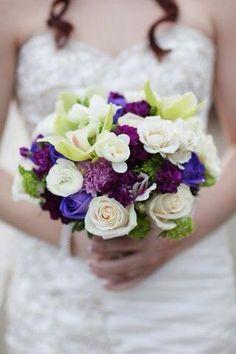 My daughter's gorgeous purple and ivory bouquet by Magnolias On Main (Mission, BC). Photo by Classic White Photography