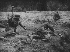 German soldier about to throw a grenade during a battle on the Eastern Front