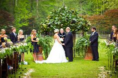 Magnolia leaves at a wedding scream southern charm. This couple had a tasetful magnolia arch for their ceremony and it fits wonderfully with the outdoor scheme.