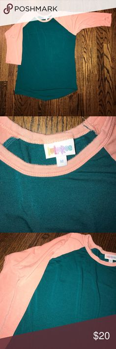 LulaRoe Randy size Medium LulaRoe size Medium Randy. Peach 🍑 sleeves and dark green base. Super cute and comfy! Perfect with OS leggings!SF/PF home. 3/4 length sleeves. Does have small stain on upper right side of front. Honestly I didn't even notice it until I looked at these pictures. LuLaRoe Tops Tees - Short Sleeve