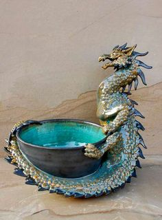 Pottery art pieces from ancient to contemporary, antiquity to futuristic, unusual to utilitarian, quirky to conservative.Clay always has something to say Dragon Bowl, Dragon 2, Fantasy Dragon, Fantasy Art, Fantasy Creatures, Mythical Creatures, Statues, Dragon Dreaming, Cool Dragons