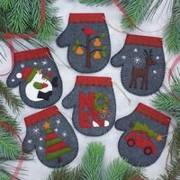Charcoal Mittens Felt Applique Christmas Ornaments Kit Rachel's of GreenfieldPURCHASED KIT - SEWING - Charcoal Mittens Ornament Sewing Kit ~ easy level ~ each approx. x ~ kit incl. wool felt, embroidery floss and gold string plus precise pattrns and Ornament Crafts, Felt Crafts, Holiday Crafts, Christmas Sewing, Handmade Christmas, Christmas Crafts, Christmas Movies, Felt Christmas Decorations, Felt Christmas Ornaments