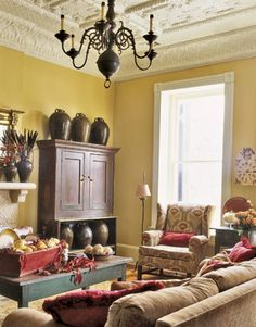 this is the color of the walls right now, yellow-tan. And I think that all of the traditional rugs we looked at has a touch of red. So... this is how the colors would look