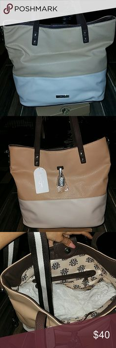 Jessica Simpson tote bag Brand new with tags Jessica Simpson getaway tote bag colors are brown tan + cream. Comes with shoulder strap. No stains tears or rips Jessica Simpson Bags Totes