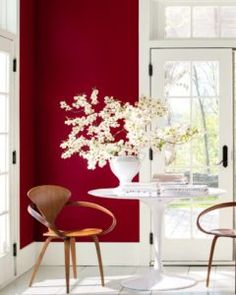 Benjamin Moore Caliente colour of the year in eating area with white tile via BM. Info via Kylie M E-design, expert advice