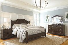 dark chocolate brown four poster bed with matching furniture set