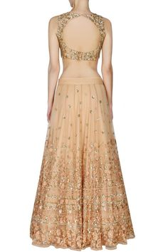 This set features a peach lehenga in net base with gold and peach thread and sequins floral work around the ghera. It has a can-can underlayer. It comes along with peach sleeveless blouse with golden Indian Bridal Lehenga, Red Lehenga, Indian Attire, Indian Ethnic Wear, Indian Style, Choli Designs, Saree Blouse Designs, Indian Fashion Dresses, Indian Outfits