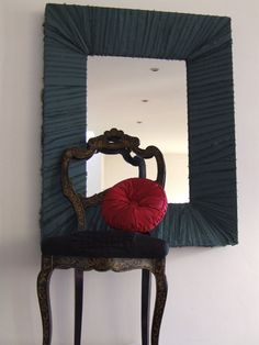 mirror frame wrapped with frayed silk strips