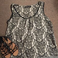 Dressy Tank size XL Violet and Claire New York size XL Dressy Tank. Colors are black and ivory and even though it's a paisley design, it is in the design of owls. Super cute and pair with a blazer for the office or a jean jacket for a casual day out. Violet and Claire Tops Blouses