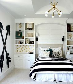 wall storage niches on either side of the bed highlight the zone