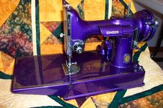 I still have my mother's and grandmother's black singer sewing machines. Granny's is in a beautiful cabinet with iron scrollwork and powered by pedal, displayed in the entryhall. Featherweight Sewing Machine, All Things Purple, Purple Stuff, Antique Sewing Machines, Purple Home, Sewing Accessories, Sewing Hacks, Bunt, Old Things