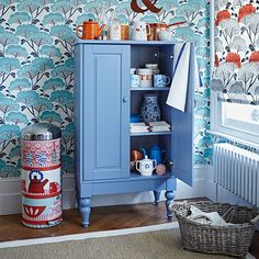 Blue kitchen with retro wallpaper | Kitchen decorating | Country Homes and Interiors | Housetohome.co.uk