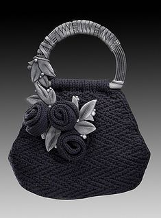 Gorgeous knitted evening bag. Do this with the handles I have and use Sashay yarn for roses. Maybe this will go together or may need further thought. :)