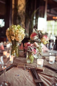 http://www.estateweddingsandevents.com/wp-content/uploads/2013/03/mason-jar-wedding-centerpiece.jpg