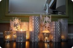 "Create a ""candle-scape"" with glass jars, decorative paper, and paper punches. This would be beautiful for an entry table."