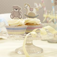 Rock-A-Bye Baby Cupcake Kit - Makes 50 Cupcakes  Code: TWCKRBB  This lovely Cupcake Kit is great for a baby shower, first birthday or Christening. There are 25 pink and yellow & 25 blue and yellow cupcake cases (width 4.5cm across the base) along with 10 Teddy & 10 Rocking Horse cupcake toppers to pop in the top of the cakes. The toppers are 4.5cm high. £3.95