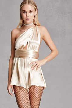 A satin sheeny romper by Reverse™ featuring a large self-tie halter with a plunging neckline, a backless design, an elasticized waist, and a flowy short.