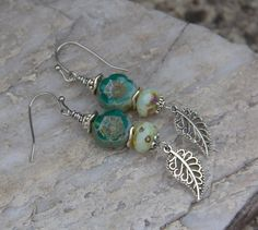 Hawaiian Aqua Turquoise Flower & Silver Leaf Earrings, Czech Glass Earrings, Dangle Earrings, Beaded Earrings by ForestberryCreations on Etsy https://www.etsy.com/listing/494552149/hawaiian-aqua-turquoise-flower-silver