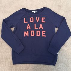 Victoria's Secret Sweatshirt Navy Blue Victoria's Secret Pullover Sweatshirt. Size Small. Coral colored lettering. Super soft terry fabric on the inside. Excellent condition-only worn twice! Victoria's Secret Tops Sweatshirts & Hoodies