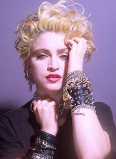 Madonna -- color photo -- her first album cover -- it's this photo in black and white. People bought it for the cover. It was radical. 1st 'sex symbol' since Marilyn Monroe, maybe. sex symbols had been out of style for a long long time cuz of feminism, hippies, 60s 70s ++ then along came Madonna in early 1980s. Little Italy played her music loud in the streets on weekend nights. I thought she was a black singer.