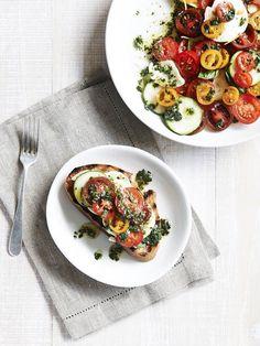 Mixed tomato salad with zucchini and Buffalo mozzarella on grilled bread.