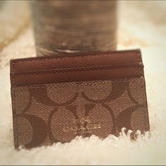 COACH card carrier !!NWT!! Never used. Card case holds at least 4 cards and cash. Classic Coach C pattern ✨ Ask questions you never know until you do ✨ no trades use the offer button no low ball offers please. Let's not waste each other's time  Happy poshing! Coach Accessories Key & Card Holders