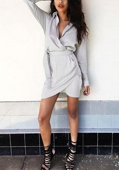 aec1fdc0ec372 Say goodbye to your usual preppy look with this tulip hem satin shirt  dress. Wrap