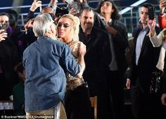 Come here Tommy! The pop star then graced her host with a kiss
