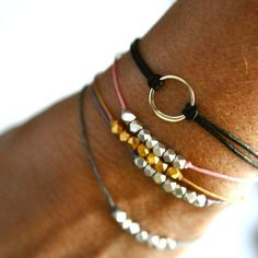 Image of Seven Wish bracelet on Teal waxed Irish linen