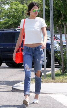 Kendall Jenner looks laid back in a casual top and ripped jeans.