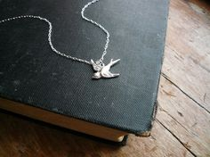 Tiny Silver Sparrow Necklace in Sterling Silver - Dainty Bird Necklace for Everyday Wear. $24.00, via Etsy.