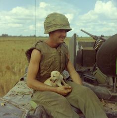 "Jackie Coulter (of Lafayette, GA) Infantry Division holds dog that had survived air strike in village near Lai Khê during ""Operation Buckskin"" on January Via US National Archives Vietnam History, Vietnam War Photos, American War, American Soldiers, Sniper Training, My War, North Vietnam, Today In History, War Photography"