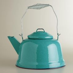 Turquoise Enamel Tea Kettle from World Market. My tea kettle got super rusty and ruined on the inside so I needed a new one! I've been trying to replace everything in my kitchen with vintage pieces, but I loved this new vintage-look tea kettle and thought it was perfect for what I'm going for! I can't wait for it to arrive!