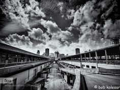 Looking Towards the City - Pinned by Mak Khalaf Montreal Quebec City and Architecture CanadaMontrealarchitectureblack and whitebuildingcitycityscapecloudsmonochromeskystreettravelurbanQeuebec by bobkolesar