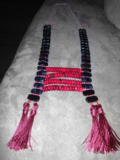Sneak peek of finished statement making statement necklace!!!  Made with blue tiger eye rectangular beads, faceted coral beads, pineapple serpentine jade Heishi beads, beautiful red coral rondelles, sterling silver chains, and red silk cord tassels. It will quickly become the piece you want to wear with everything!!! It is perfect for year round wear!!!!