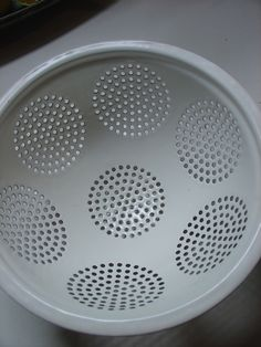 circle pattern in a metal colander