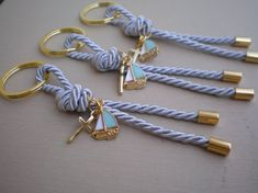 Elegant Key chains martyrika for the Orthodox baptism day Navy martyrika with enamel ship and cross in golden shade . They can also be used as favors Key rings diameter is 1.18 Total lenght including the key ring, about 4,72 All your guests will leave with a keepsake from your
