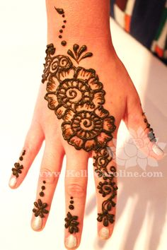 henna tattoo - you can get one anywhere on your body. Safe and temporary.