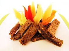 Campfire made with brown bread, cheese, carrots and red capsicum