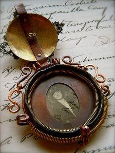 Inside of locket, made with old bottle cap!