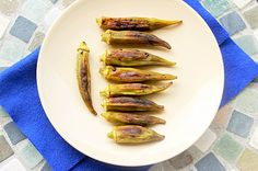 Roasted Okra. Whole okra pods seasoned and roasted in a hot oven. #okra #roasted #southernfood #southern