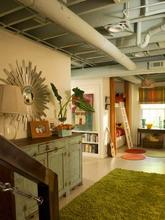 Basement WOW (notice the bunk beds built right in) painted ceiling, bright colors, area rugs, efficient