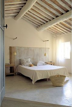 Rustic farmhouse bedroom in an ancient farmhouse with pale colors. European Farmhouse and French Country Decorating Style Photos.